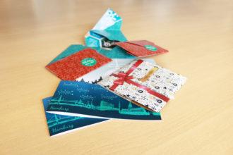 Gestaltung und Digitaldruck für Karten mit Weihnachts- und Neujahrswuenschen